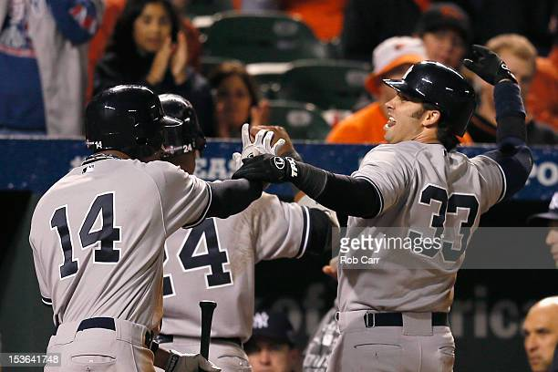 Curtis Granderson and Nick Swisher of the New York Yankees celebrate after they both scored during the ninth inning of the the Yankees 72 win over...