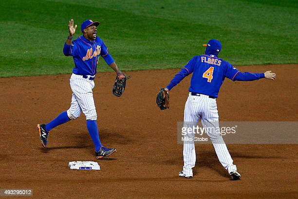 Curtis Granderson and Wilmer Flores of the New York Mets celebrate after defeating the Chicago Cubs in game two of the 2015 MLB National League...