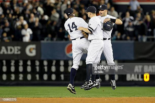Curtis Granderson Brett Gardner and Nick Swisher of the New York Yankees celebrate after the Yankees won 72 against the Texas Rangers in Game Five of...
