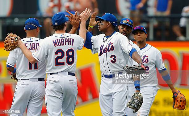 Curtis Granderson Daniel Murphy and Ruben Tejada of the New York Mets celebrate after defeating the Philadelphia Phillies at Citi Field on July 30...