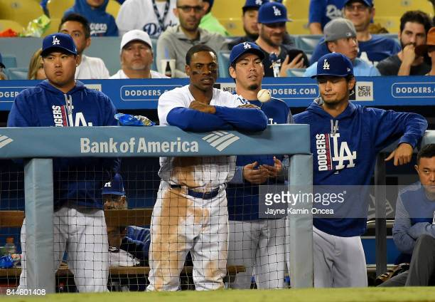 Curtis Granderson Kenta Maeda and Yu Darvish of the Los Angeles Dodgers watch during th eighth inning of the game against the Colorado Rockies from...