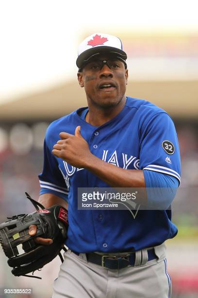Curtis Granderson of the Blue Jays trots off the field between innings during the spring training game between the Toronto Blue Jays and the...