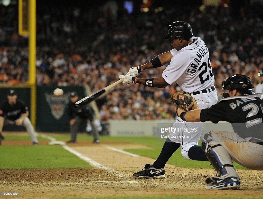 Curtis Granderson #28 of the Detroit Tigers bats against the Toronto Blue Jays during the game at Comerica Park on September 12, 2009 in Detroit, Michigan. The Blue Jays defeated the Tigers 8-6.