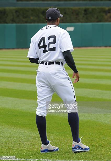 Curtis Granderson of the Detroit Tigers looks on wearing jersey and special spikes to honor Jackie Robinson against the Chicago White Sox during the...