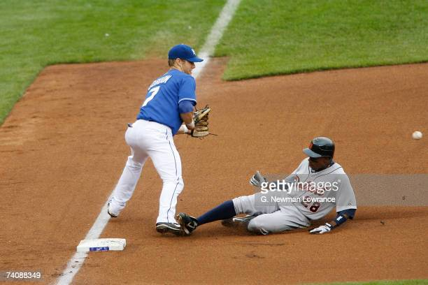 Curtis Granderson of the Detroit Tigers slides in for a triple against the Kansas City Royals at Kauffman Stadium May 6 2007 in Kansas City Missouri