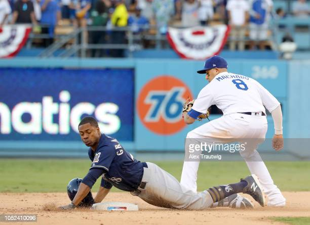 Curtis Granderson of the Milwaukee Brewers gets hit in the face by his helmet as he slides into second base in the ninth inning of Game 5 of the NLCS...