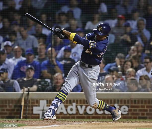 Curtis Granderson of the Milwaukee Brewers hit a solo home run in the 9th inning against the Chicago Cubs at Wrigley Field on September 12 2018 in...