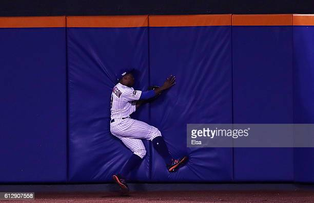 Curtis Granderson of the New York Mets catches a ball hit by Brandon Belt of the San Francisco Giants for an out in the sixth inning during their...