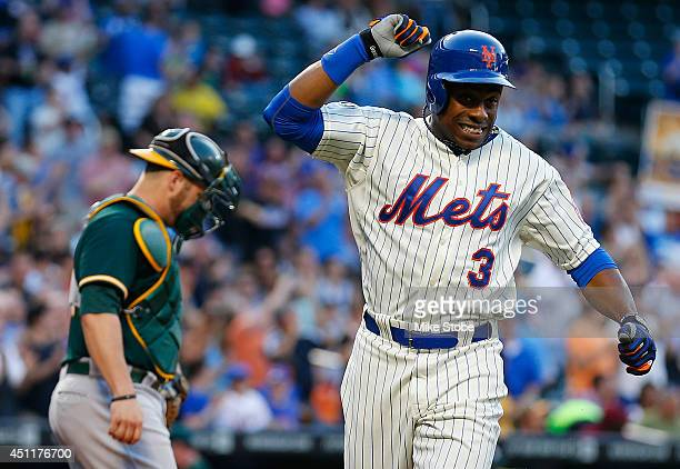 Curtis Granderson of the New York Mets celebrates after hitting a tworun home run in the second inning aagainst thhe Oakland Athletics at Citi Field...