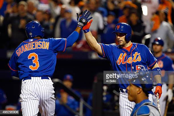 Curtis Granderson of the New York Mets celebrates with David Wright of the New York Mets after hitting a solo home run in the first inning against...