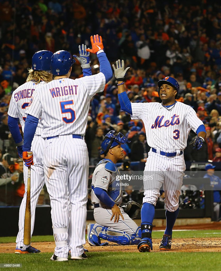 Curtis Granderson #3 of the New York Mets celebrates with Noah Syndergaard #34 and David Wright #5 after hitting a two run home run in the third inning against the Kansas City Royals during Game Three of the 2015 World Series at Citi Field on October 30, 2015 in New York City.