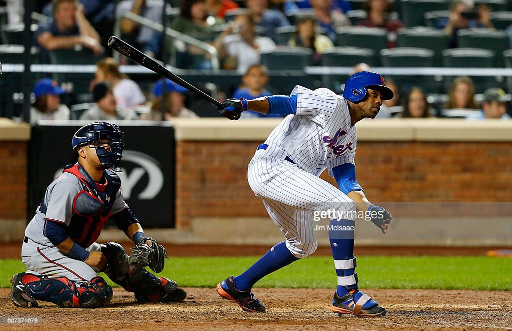 Curtis Granderson #3 of the New York Mets follows through on a his twelfth inning game winning home run against the Minnesota Twins at Citi Field on September 17, 2016 in the Flushing neighborhood of the Queens borough of New York City.