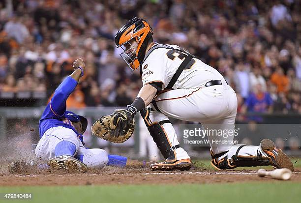 Curtis Granderson of the New York Mets gets tagged out at the plate by Andrew Susac of the San Francisco Giants in the top of the six inning at ATT...