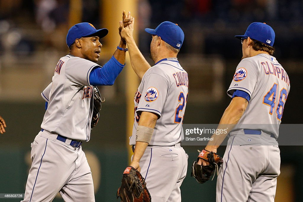 Curtis Granderson #3 of the New York Mets high-fives teammates after the game against the Philadelphia Phillies at Citizens Bank Park on August 26, 2015 in Philadelphia, Pennsylvania. The Mets won 9-4.