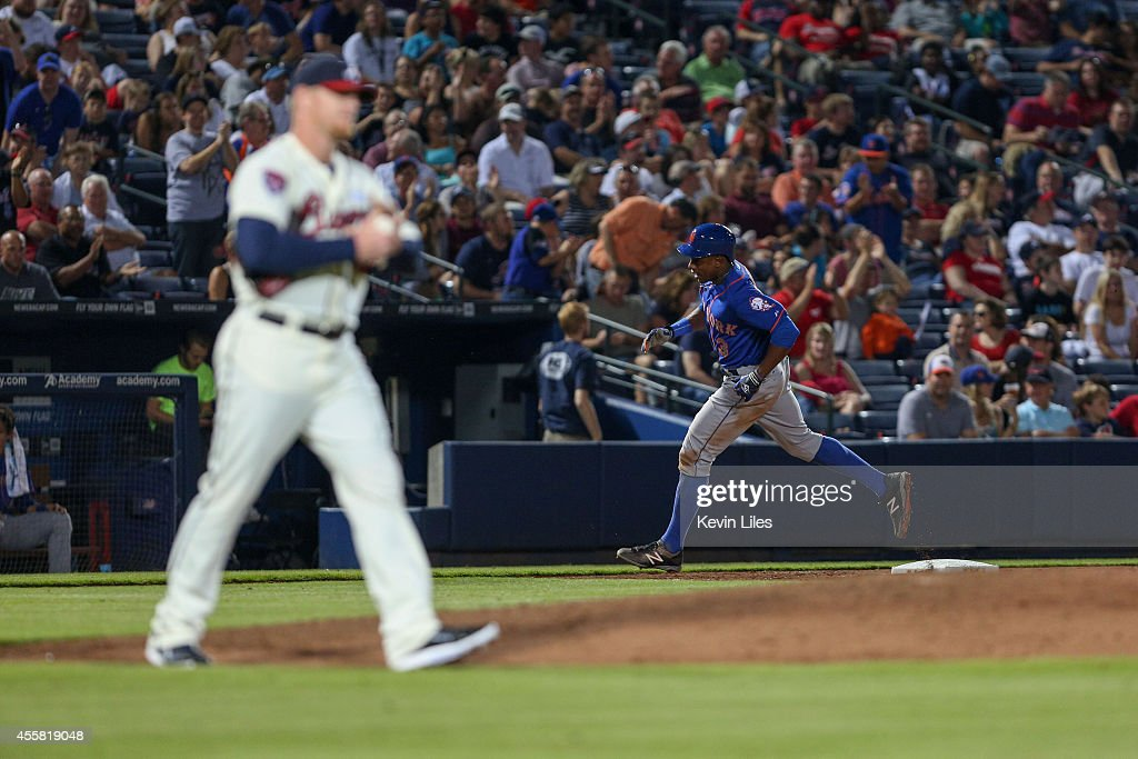 Curtis Granderson #3 of the New York Mets hits a home run during the 8th inning against David Carpenter (48) of the Atlanta Braves at Turner Field on September 20, 2014 in Atlanta, Georgia.