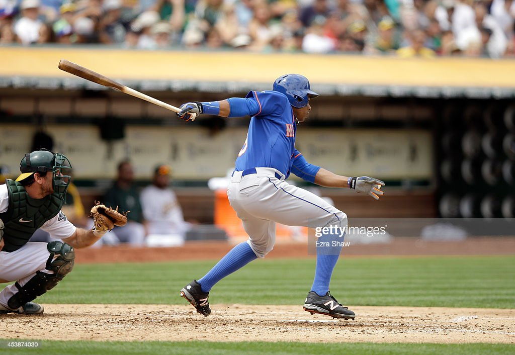 Curtis Granderson #3 of the New York Mets hits a single that scored Wilmer Flores #4 in the fourth inning of their game against the Oakland Athletics at O.co Coliseum on August 20, 2014 in Oakland, California.