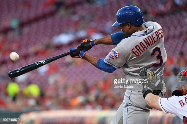 Curtis Granderson of the New York Mets hits a solo home run in the second inning against the Cincinnati Reds at Great American Ball Park on September...