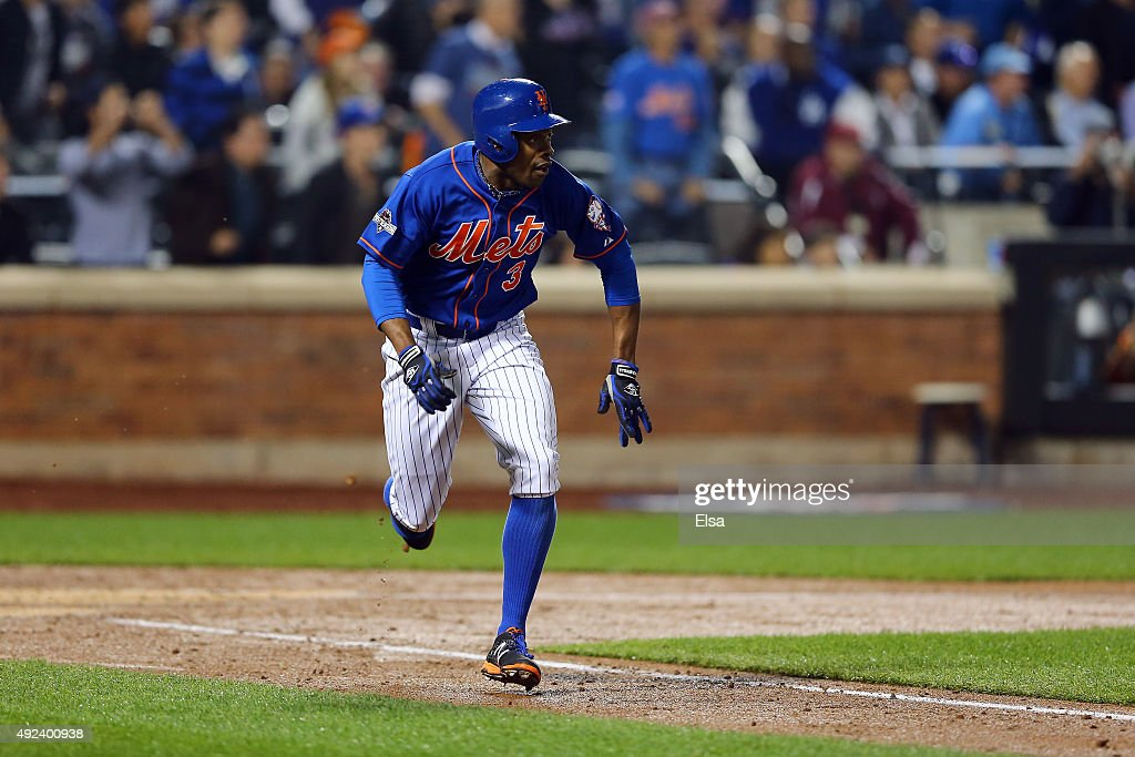 Curtis Granderson #3 of the New York Mets hits a three run double in the second inning against Brett Anderson #35 of the Los Angeles Dodgers during game three of the National League Division Series at Citi Field on October 12, 2015 in New York City.