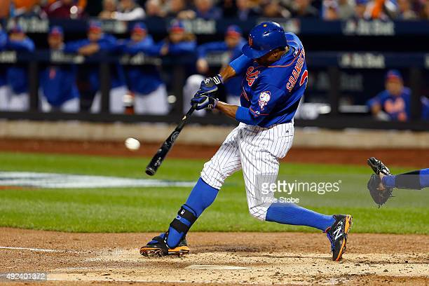 Curtis Granderson of the New York Mets hits a three run double in the second inning against Brett Anderson of the Los Angeles Dodgers during game...