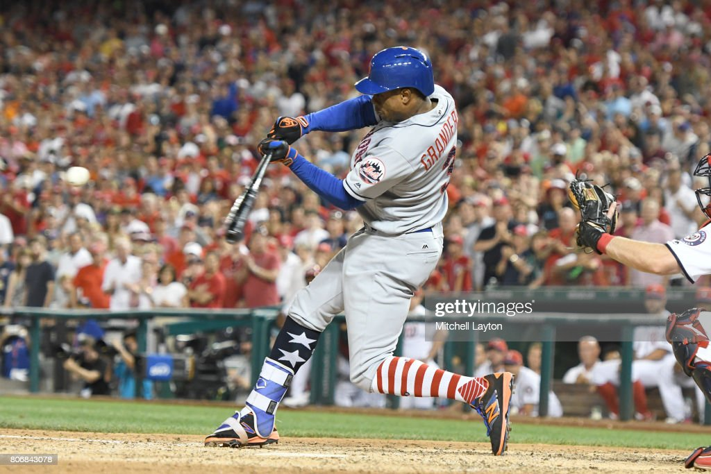 Curtis Granderson #3 of the New York Mets hits a two run home run in the ninth inning during a baseball game against the Washington Nationals at Nationals Park on July 3, 2017 in Washington, DC.