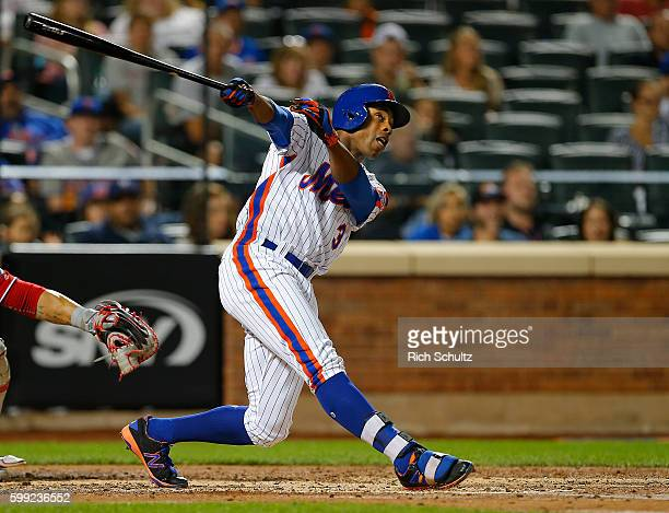 Curtis Granderson of the New York Mets hits a two run home run against the Washington Nationals during the third inning of game at Citi Field on...