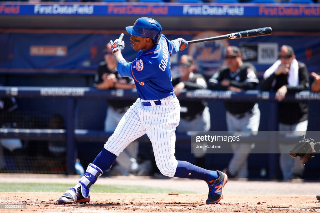 Curtis Granderson #3 of the New York Mets hits a two-run home run in the first inning of a Grapefruit League spring training game against the Miami Marlins at Tradition Field on March 22, 2017 in Port St. Lucie, Florida.