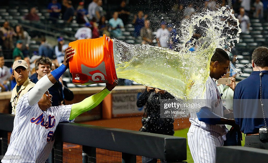 Curtis Granderson #3 of the New York Mets is doused with Gatorade after his twelfth inning game winning home run against the Minnesota Twins by teammate Yoenis Cespedes #52 at Citi Field on September 17, 2016 in the Flushing neighborhood of the Queens borough of New York City.