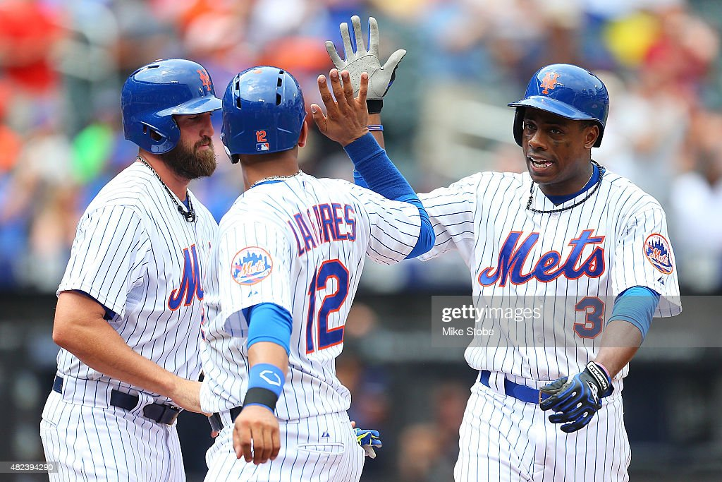 Curtis Granderson #3 of the New York Mets is greeted by Juan Lagares #12 and Jonathon Niese #49 after hitting a three run home run in the fifth inning against the San Diego Padres at Citi Field on July 30, 2015 in Flushing neighborhood of the Queens borough of New York City.