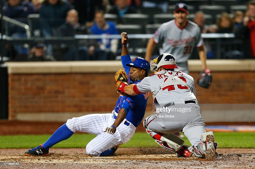 Curtis Granderson #3 of the New York Mets is tagged out by Wilson Ramos #40 of the Washington Nationals trying to score on Juan Lagares #12 single in the fifth inning at Citi Field on May 1, 2015 in the Flushing neighborhood of the Queens borough of New York City.