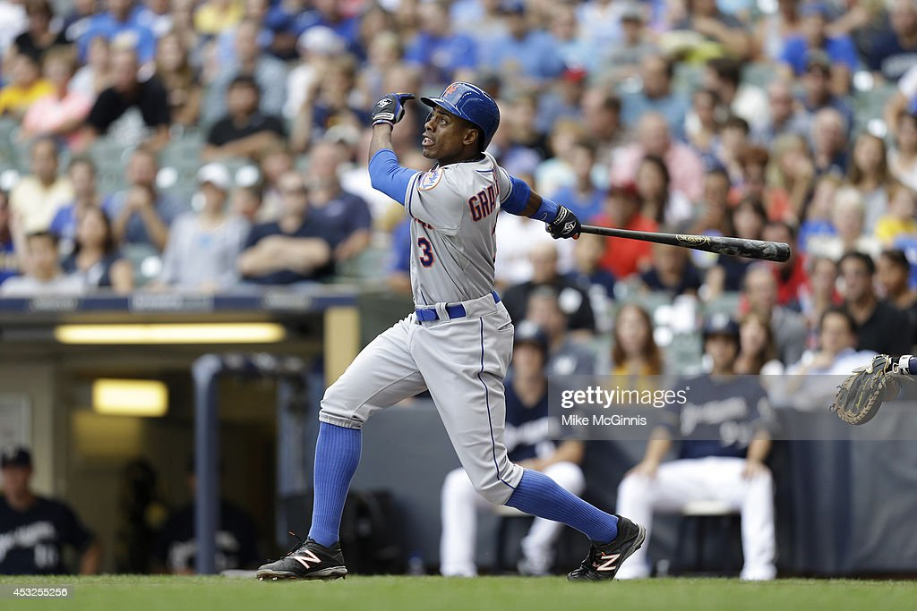 Curtis Granderson #3 of the New York Mets makes some contact at the plate during the Interleague game against the Milwaukee Brewers at Miller Park on July 26, 2014 in Milwaukee, Wisconsin.