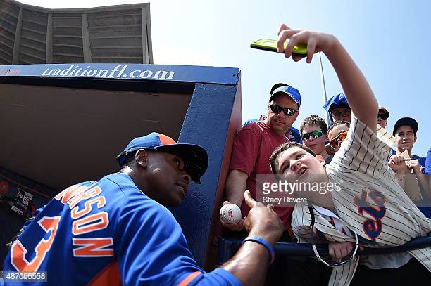 Curtis Granderson of the New York Mets poses for a picture with a fan prior to a spring training game against the St Louis Cardinals at Tradition...