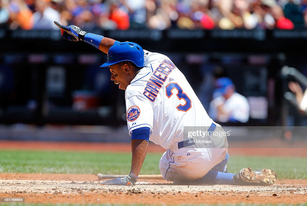 Curtis Granderson #3 of the New York Mets reacts after scoring a first inning run against the Texas Rangers at Citi Field on July 6, 2014 in the Flushing neighborhood of the Queens borough of New York City.