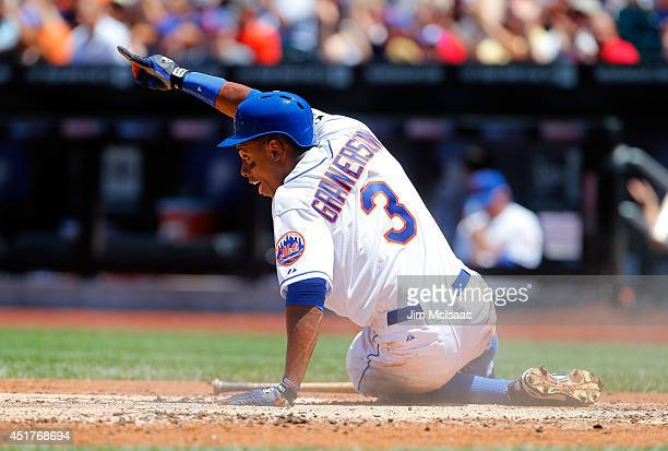 Curtis Granderson of the New York Mets reacts after scoring a first inning run against the Texas Rangers at Citi Field on July 6 2014 in the Flushing...