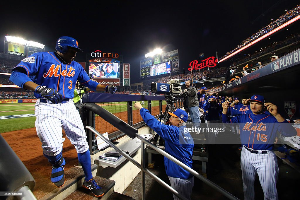 Curtis Granderson #3 of the New York Mets reacts at the dugout after hitting a solo home run in the first inning against the Kansas City Royals during Game Five of the 2015 World Series at Citi Field on November 1, 2015 in the Flushing neighborhood of the Queens borough of New York City.