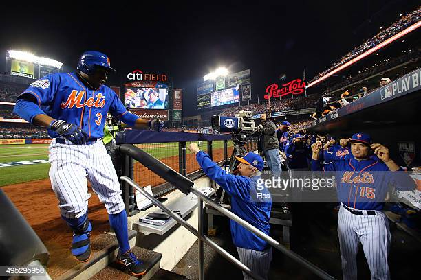 Curtis Granderson of the New York Mets reacts at the dugout after hitting a solo home run in the first inning against the Kansas City Royals during...