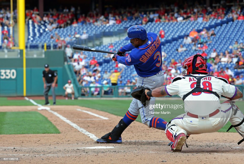 Curtis Granderson #3 of the New York Mets singles in the seventh inning during a game against the Philadelphia Phillies at Citizens Bank Park on August 13, 2017 in Philadelphia, Pennsylvania. The Mets won 6-2.