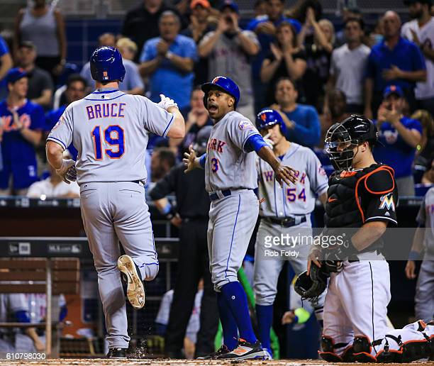 Curtis Granderson of the New York Mets waits behind home plate as Jay Bruce scores a run during the second inning of the game against the Miami...