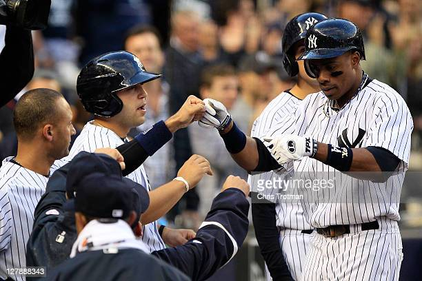 Curtis Granderson of the New York Yankees celebrates a home run against the Detroit Tigers in the eighth inning of Game Two of the American League...