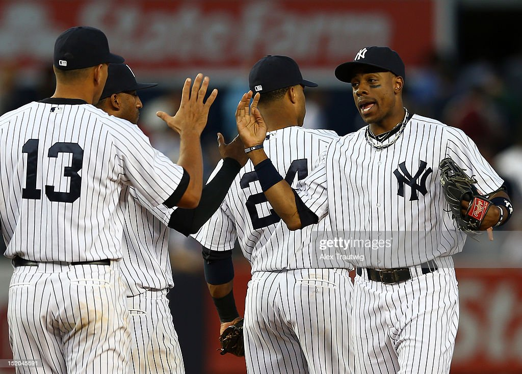 Curtis Granderson #14 of the New York Yankees celebrates the win with teamamte Alex Rodriguez after the game against the Tampa Bay Rays on September 15, 2012 at Yankee Stadium in the Bronx borough of New York City.