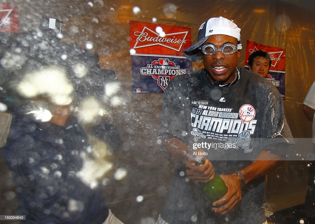 Curtis Granderson #14 of the New York Yankees celebrates winning the American League East Division Championship after their 14-2 win against the Boston Red Sox on October 3, 2012 at Yankee Stadium in the Bronx borough of New York City.