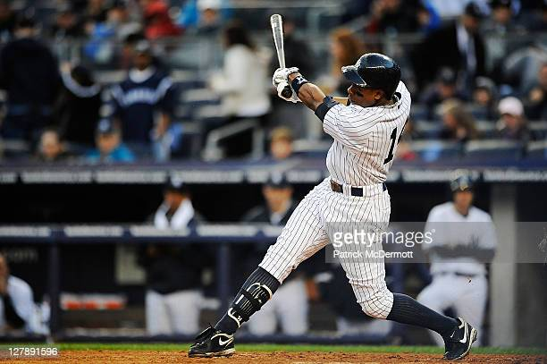 Curtis Granderson of the New York Yankees hits a home run against the Detroit Tigers in the eighth inning of Game Two of the American League Division...