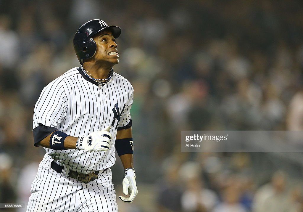 Curtis Granderson #14 of the New York Yankees hits a three run home run against the Boston Red Sox in the third inning during their game on October 3, 2012 at Yankee Stadium in the Bronx borough of New York City