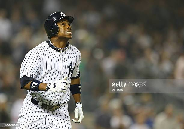 Curtis Granderson of the New York Yankees hits a three run home run against the Boston Red Sox in the third inning during their game on October 3...