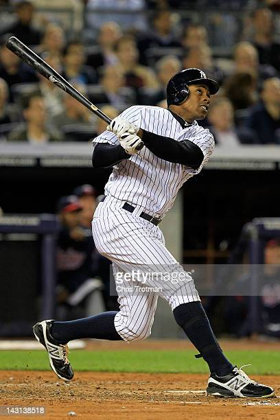 Curtis Granderson of the New York Yankees hits a two run homer in the second inning against the Minnesota Twins on April 19 2012 at Yankee Stadium in...