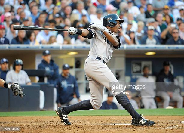 Curtis Granderson of the New York Yankees hits a tworun homer during the seventh inning of a baseball game against the San Diego Padres at Petco Park...