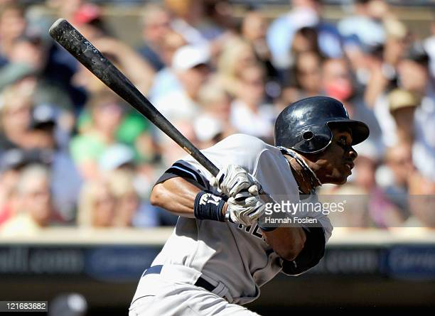 Curtis Granderson of the New York Yankees hits an inside the park home run against the Minnesota Twins in the ninth inning on August 21 2011 at...