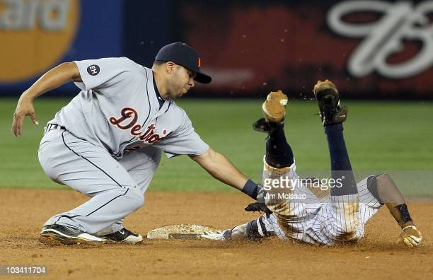 Curtis Granderson of the New York Yankees is caught stealing to end the fifth inning by Carlos Guillen of the Detroit Tigers on August 16 2010 at...