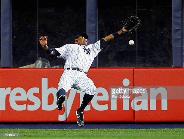 Curtis Granderson of the New York Yankees misjudges a flyable hit by Pedro Ciraco of the Boston Red Sox that rolled for a triple and allowed the...