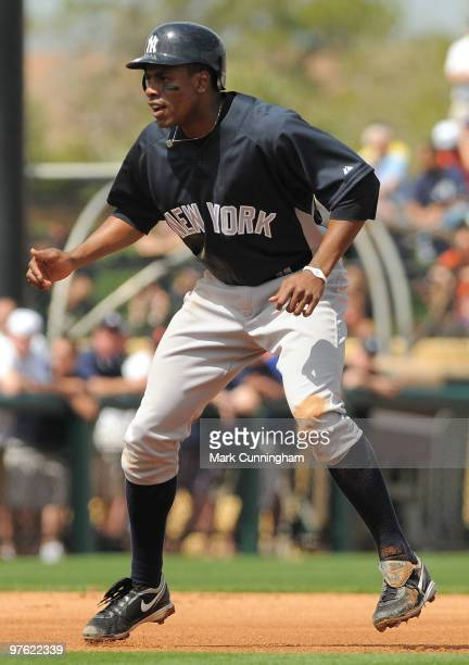 Curtis Granderson of the New York Yankees runs the bases against the Detroit Tigers during a spring training game at Joker Marchant Stadium on March...