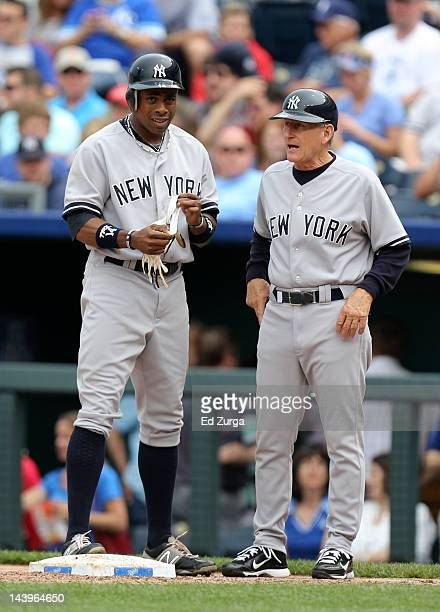 Curtis Granderson of the New York Yankees stands next to Mick Kelleher after hitting a single in a game against the Kansas City Royals at Kauffman...
